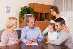 Multigenerational family making shopping list Royalty Free Stock Image