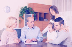 Multigenerational family making shopping list Royalty Free Stock Images