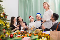 Multigenerational family sitting at festive table Stock Images
