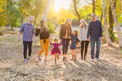 Walking Multigenerational Mixed Race Family Outdoors. Multigenerational Mixed Race Family Walking Outdoors in the Woods stock photo