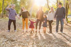 Active Multigenerational Mixed Race Family Portrait Outdoors. Multigenerational Mixed Race Family Walking Outdoors in the Woods royalty free stock images