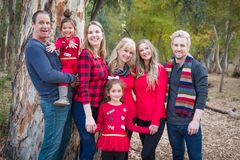 Multigenerational Mixed Race Family Portrait Outdoors. Multigenerational Mixed Race Pose for a Family Portrait Outdoors royalty free stock photography