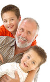 Multigenerational portrait. Happy grandpa and his little blessings Royalty Free Stock Photo