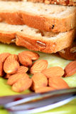 Multigrain bread and almonds Royalty Free Stock Photos