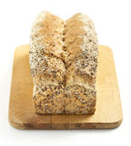 Multigrain bread on a chopping board Royalty Free Stock Images
