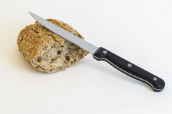 Multigrain bread and knife Royalty Free Stock Images