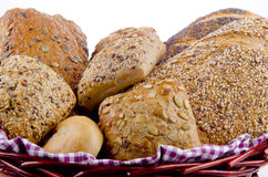 Multigrain bread and roll in a basket Royalty Free Stock Image