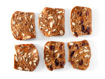 Multigrain bread slices with fruits and nuts close-up on white Stock Photo