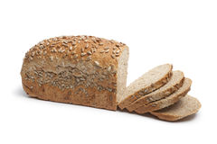 Multigrain bread with sunflower seeds. Fresh wholewheat bread with sunflower seeds and slices on white background Stock Images