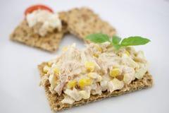 Multigrain crispbread. Multigrain crisp bread and tuna salad Royalty Free Stock Photo