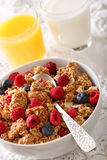 Multigrain granola with dried raspberries, nuts and blueberries,. Milk and juice close-up on the table. vertical Stock Photos