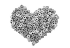 Multigrain hoops breakfast cereal heart Royalty Free Stock Image