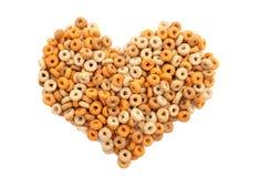Multigrain hoops breakfast cereal heart Royalty Free Stock Images