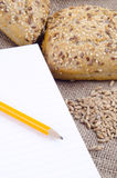 Multigrain roll and a booklet for notes Stock Photography