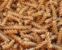Multigrain spiral pasta. Uncooked multigrain spiral pasta in bulk Royalty Free Stock Photography