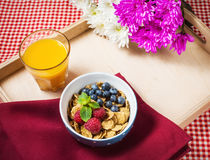 Multigrain wholewheat healthy cereals with fresh berry and a glass of juice for breakfast Stock Photo