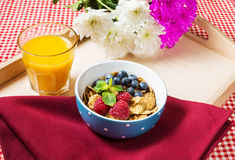 Multigrain wholewheat healthy cereals with fresh berry and a glass of juice for breakfast Stock Images