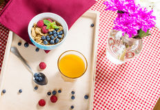 Multigrain wholewheat healthy cereals with fresh berry and a glass of juice for breakfast Royalty Free Stock Photos