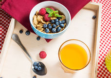 Multigrain wholewheat healthy cereals with fresh berry and a glass of juice for breakfast Royalty Free Stock Photography