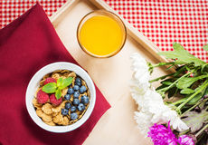 Multigrain wholewheat healthy cereals with fresh berry and a glass of juice for breakfast Royalty Free Stock Image