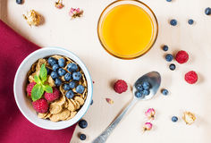 Multigrain wholewheat healthy cereals with fresh berry and a glass of juice for breakfast Stock Photography