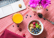 Multigrain wholewheat healthy cereals with fresh berry and a glass of juice for breakfast Royalty Free Stock Images