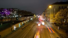 Multilane street night time-lapse in Vienna. Zoom in aerial view time-lapse of nightly traffic jam on the Waehringer Guertel near the Vienna General Hospital AKH stock footage