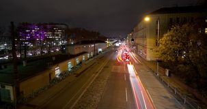 Multilane street night time-lapse in Vienna. Zoom in aerial view time-lapse of nightly traffic on the Waehringer Guertel near the Vienna General Hospital AKH in stock video