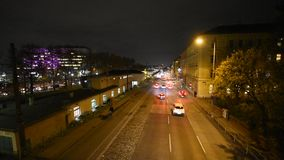 Multilane street at night in Vienna. Aerial view of nightly traffic on the Waehringer Guertel near Michelbeuern, where the Vienna General Hospital AKH is located stock video footage