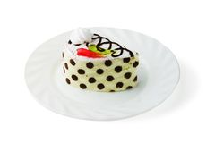 Multilayer biscuit cake on the plate Royalty Free Stock Photo
