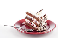 Multilayer cake on plate with spoon Stock Photography