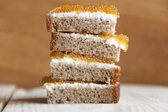 Multilayer sandwich of bread and pike caviar. Royalty Free Stock Photos
