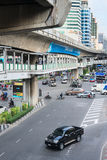Multilevel Bangkok with traffic on street, pedestrian and SkyTra Royalty Free Stock Photo