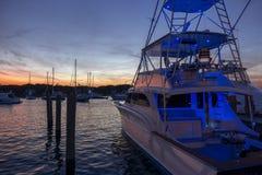 Multilevel motor boat with sunrise sunset sky dark reflections w stock image