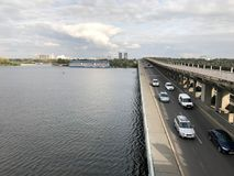 Multilevel road, bridge with cars over the river. Kiev, Ukraine Royalty Free Stock Image