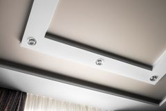 Multilevel suspended and suspended ceiling of plasterboard. Modern interior stock photo