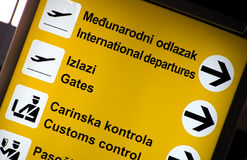Multilingual Airport signs Stock Photography
