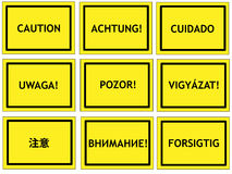 Multilingual caution signs royalty free stock photography