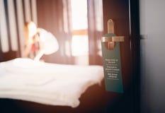 Multilingual hotel door hanger Stock Photography