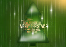 Multilingual merry christmas green fir Stock Photography