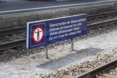 Multilingual warning sign at the railroad station platform Royalty Free Stock Photography