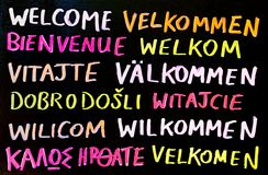 Multilingual Welcome Sign. A multilingual welcome sign, written on a chalk board Royalty Free Stock Photography