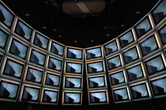 Multimedia. A wall with a matrix of TV-sets Royalty Free Stock Image