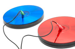 Multimedia colors. Red and blue compact discs with headphone and microphone cords Stock Images
