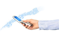 Multimedia concept. Mobile phone in hand. Isolated over white Stock Photos