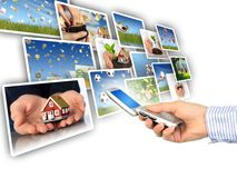Multimedia concept. Mobile phone in hand. Isolated over white Stock Image