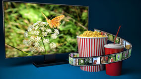 Multimedia display for watching movies Stock Images