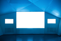Multimedia exhibition room. Projection screen and two tv royalty free stock images