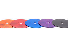 Multimedia - full of colors. Row of CD (DVD) discs of differentcolors isolated Royalty Free Stock Image