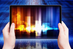 Multimedia gadget. Abstract tablet pc with equalizer on screen in hands, multimedia gadget stock image